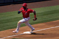 Los Angeles Angels' Justin Upton rounds third to score on a base hit by Kurt Suzuki during the second inning of a spring training baseball game against the Kansas City Royals, Wednesday, March 24, 2021, in Tempe, Ariz. (AP Photo/Matt York)