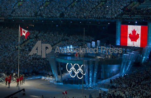 The Canadian flag is raise by an RCMP honour guard at the opening ceremonies for the XXI Olympic Winter Games in Vancouver, Friday, Feb. 12, 2009. (AP Photo/Nathan Denette, CP)