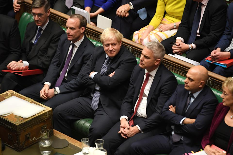 """Britain's Prime Minister Boris Johnson looks on, with arms crossed, next to Brexit Secretary Stephen Barclay ahead of a vote on the prime minister's renegotiated Brexit deal, on what has been dubbed """"Super Saturday"""", in the House of Commons in London, Britain October 19, 2019. ©UK Parliament/Jessica Taylor/Handout via REUTERS ATTENTION EDITORS - THIS IMAGE WAS PROVIDED BY A THIRD PARTY"""