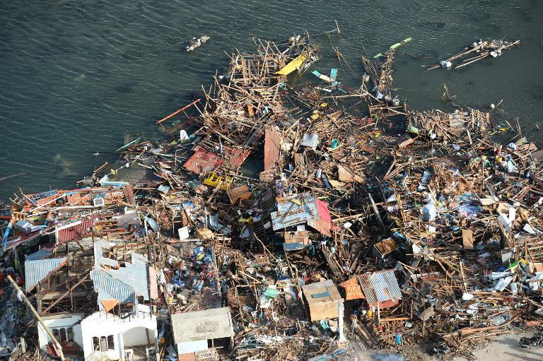 Debris clogs the coastline near the pier in the town of Guiuan in Eastern Samar province, central Philippines on November 11, 2013, four days after Typhoon Haiyan hit the country