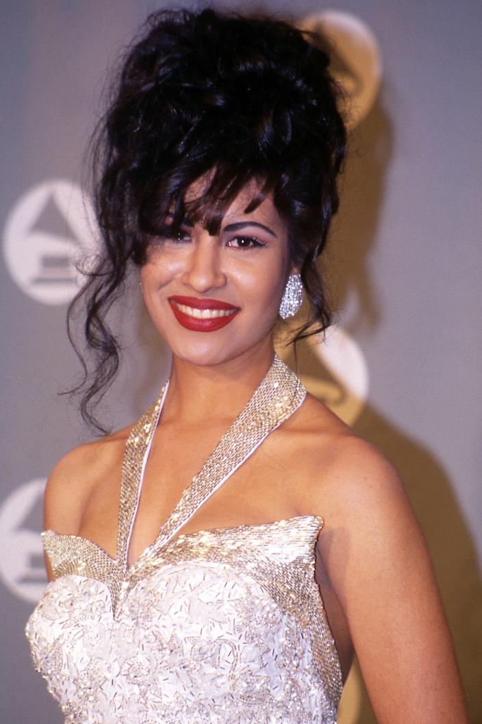 """<h3>Selena Quintanilla, 1994</h3><br>One of her <a href=""""https://www.youtube.com/watch?v=k9dt1f4MxFM"""" rel=""""nofollow noopener"""" target=""""_blank"""" data-ylk=""""slk:most iconic looks"""" class=""""link rapid-noclick-resp"""">most iconic looks</a>, the late Selena Quintanilla accepted her only Grammy in 1995 with an updo that featured loose curls and lots of height.<span class=""""copyright"""">Photo: Vinnie Zuffante/Getty Images.</span>"""