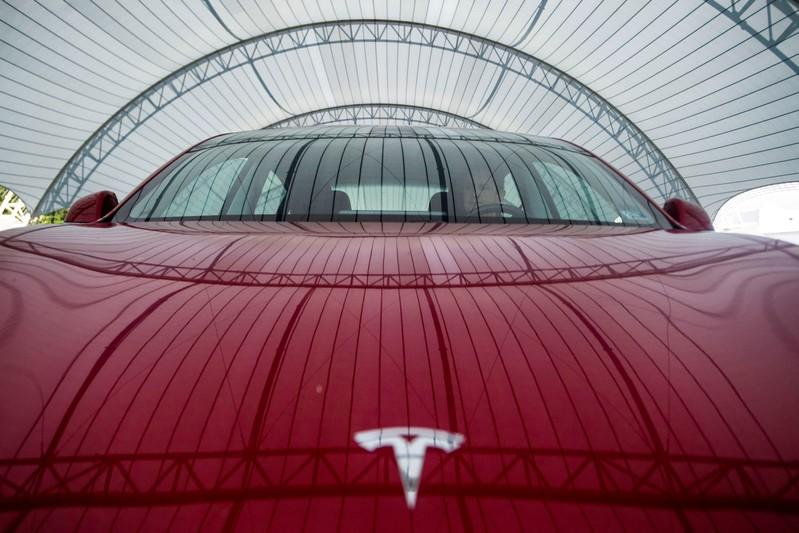 FILE PHOTO: FILE PHOTO: FILE PHOTO: FILE PHOTO: IIHS technician Floyd demonstrates front crash prevention test on Tesla Model 3 at IIHS-HLDI Vehicle Research Center in Ruckersville, Virginia