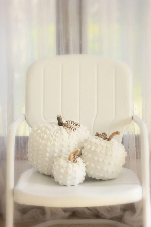 """<p>These refined decorations in pure white add a touch of chic to any porch.</p><p><strong>Get the tutorial at <a href=""""http://erin-artandgardens.blogspot.com/2011/10/white-chenille-punkins.html"""" rel=""""nofollow noopener"""" target=""""_blank"""" data-ylk=""""slk:Erin's Art and Gardens"""" class=""""link rapid-noclick-resp"""">Erin's Art and Gardens</a>.</strong> </p>"""