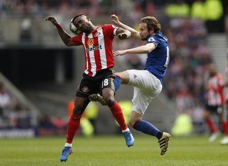 Sunderland's Jermain Defoe in action with Manchester United's Daley Blind