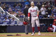 Philadelphia Phillies' Bryce Harper drops his helmet after striking out during the eighth inning of a baseball game against the Miami Marlins, Saturday, Oct. 2, 2021, in Miami. Miami won 3-1. (AP Photo/Lynne Sladky)
