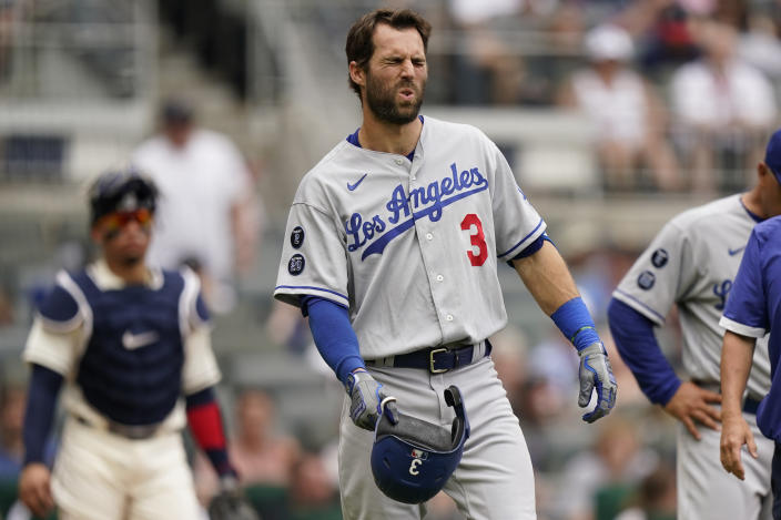 Los Angeles Dodgers' Chris Taylor (3) reacts after fouling a pitch off his foot in the fourth inning of a baseball game against the Atlanta Braves, Sunday, June 6, 2021, in Atlanta. Taylor remained in the game. (AP Photo/Brynn Anderson)