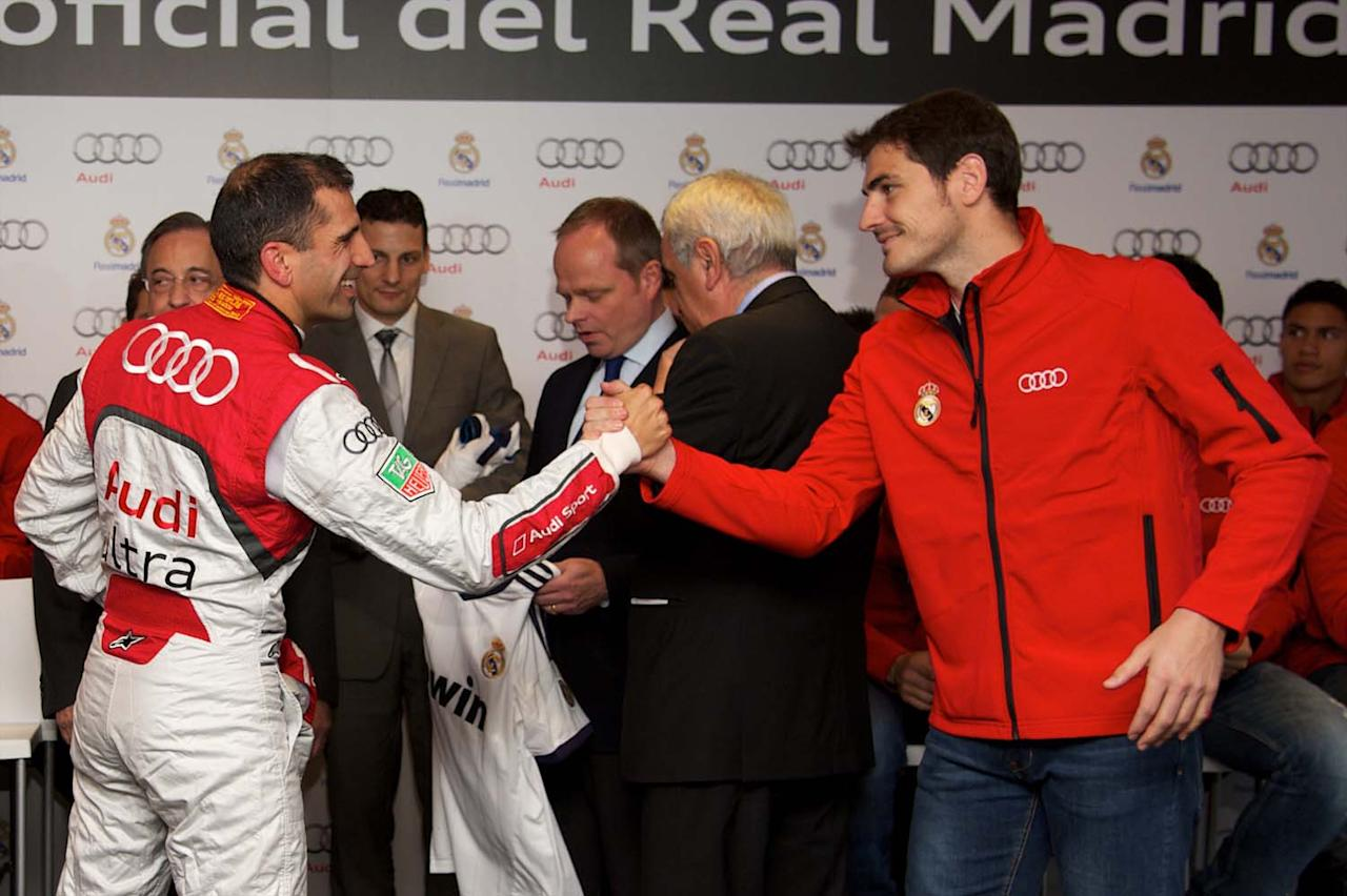 MADRID, SPAIN - NOVEMBER 08:  Driver Marc Gene (L) and Real Madrid player Iker Casillas (R) pose for the photographers during the presentation of Real Madrid's new cars made by Audi at the Jarama racetrack on November 8, 2012 in Madrid, Spain.  (Photo by Carlos Alvarez/Getty Images)