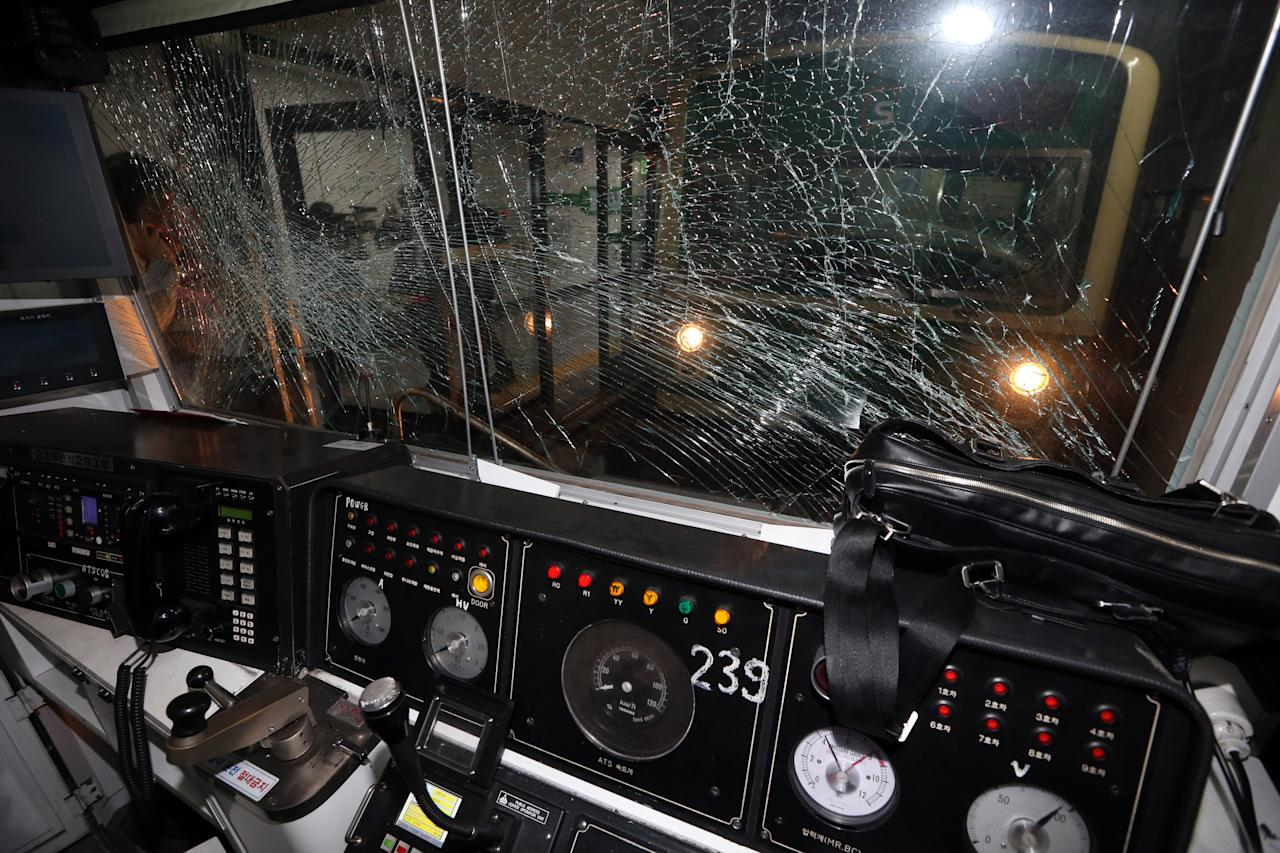 A window of a subway train is broken after a collision at Sangwangshipri subway station in Seoul, South Korea, Friday, May. 2, 2014. A subway train plowed into another train stopped at the station Friday, causing minor injuries for scores of people, a city official said. (AP Photo/Yonhap, Park Dong-ju) KOREA OUT