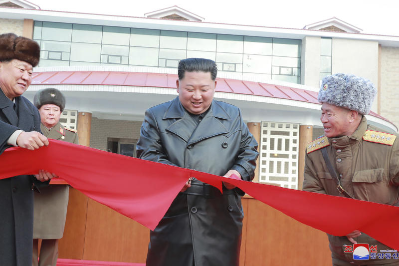 """In this Dec. 7, 2019, photo provided by the North Korean government, North Korean leader Kim Jong Un, center, cuts the ribbon during a ceremonial opening of the Yangdok Hot Spring Cultural Recreation Center in South Pyongan Province, North Korea. Independent journalists were not given access to cover the event depicted in this image distributed by the North Korean government. The content of this image is as provided and cannot be independently verified. Korean language watermark on image as provided by source reads: """"KCNA"""" which is the abbreviation for Korean Central News Agency. (Korean Central News Agency/Korea News Service via AP)"""