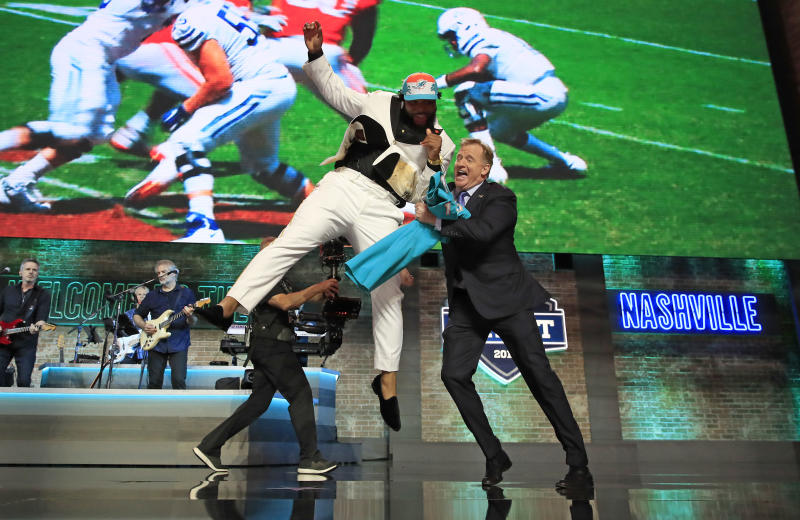 Christian Wilkins of Clemson celebrates with NFL Commissioner Roger Goodell after being chosen No. 13 overall by the Miami Dolphins during the first round of the 2019 NFL draft. (Photo by Andy Lyons/Getty Images)