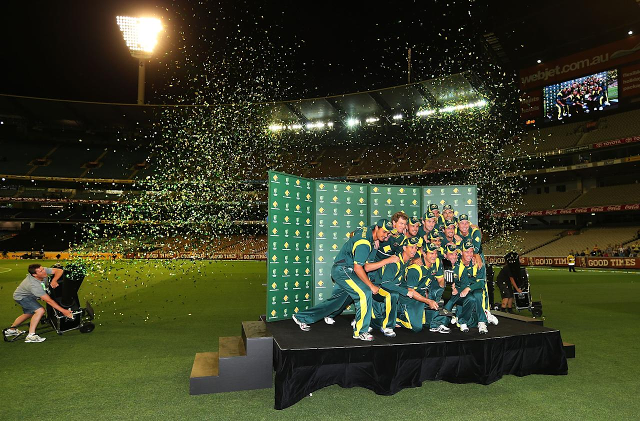 MELBOURNE, AUSTRALIA - FEBRUARY 10:  The Australian team poses with the trophy after their win in game five of the Commonwealth Bank International Series between Australia and the West Indies at Melbourne Cricket Ground on February 10, 2013 in Melbourne, Australia.  (Photo by Michael Dodge/Getty Images)