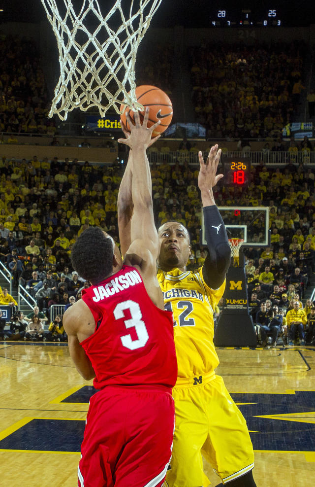 Ohio State guard C.J. Jackson (3) defends against a shot-attempt from Michigan guard Muhammad-Ali Abdur-Rahkman (12) in the first half of an NCAA college basketball game at Crisler Center in Ann Arbor, Mich., Sunday, Feb. 18, 2018. (AP Photo/Tony Ding)