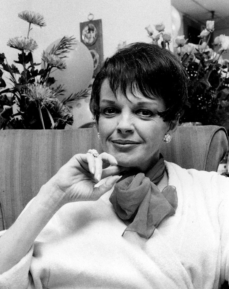 """FILE - In a July 31, 1967 file photo, actress-singer Judy Garland poses backstage at the Palace Theater in New York. A drama about the last months of Judy Garland's life is coming to Broadway this spring. Peter Quilter's """"End of the Rainbow"""" is set to begin performances March 19, 2012 at a theater to be announced. Tracie Bennett, a two-time Oliver Award winner who originated the role of Garland in London, will reprise her role on Broadway.   (AP Photo, File)"""