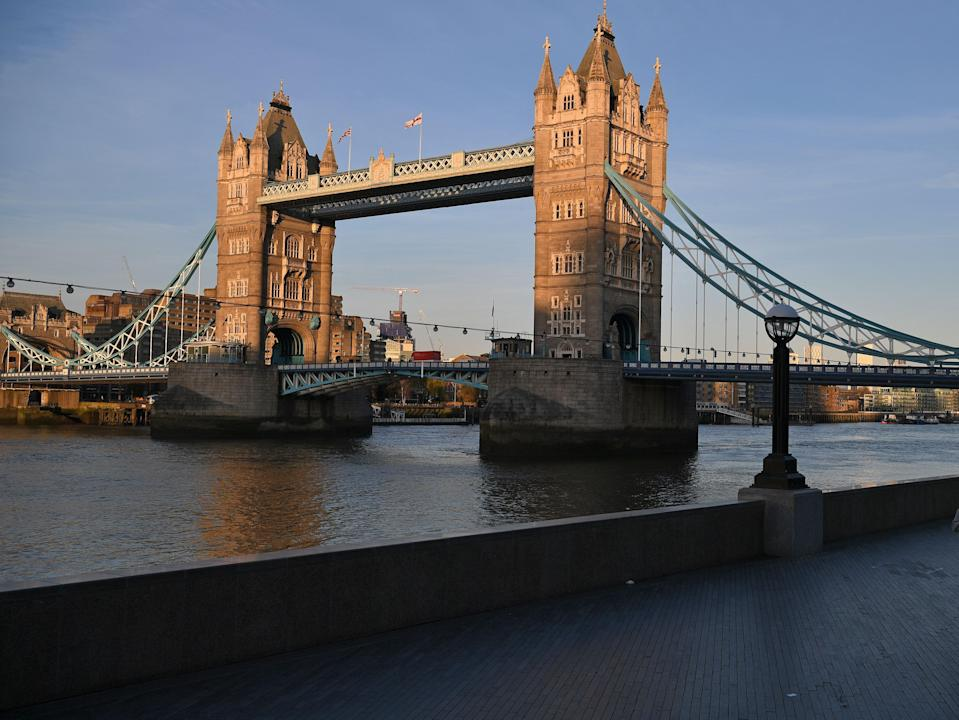 <p>Police are investigating what happened after the boy got off the bus near Tower Bridge</p> (AFP via Getty Images)