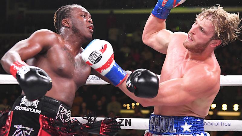 Logan Paul (red/white/blue shorts) and KSI (black/red) exchange punches their pro debut fight at Staples Center on November 9, 2019 in Los Angeles, California. KSI won by decision. (Photo by Jayne Kamin-Oncea/Getty Images)
