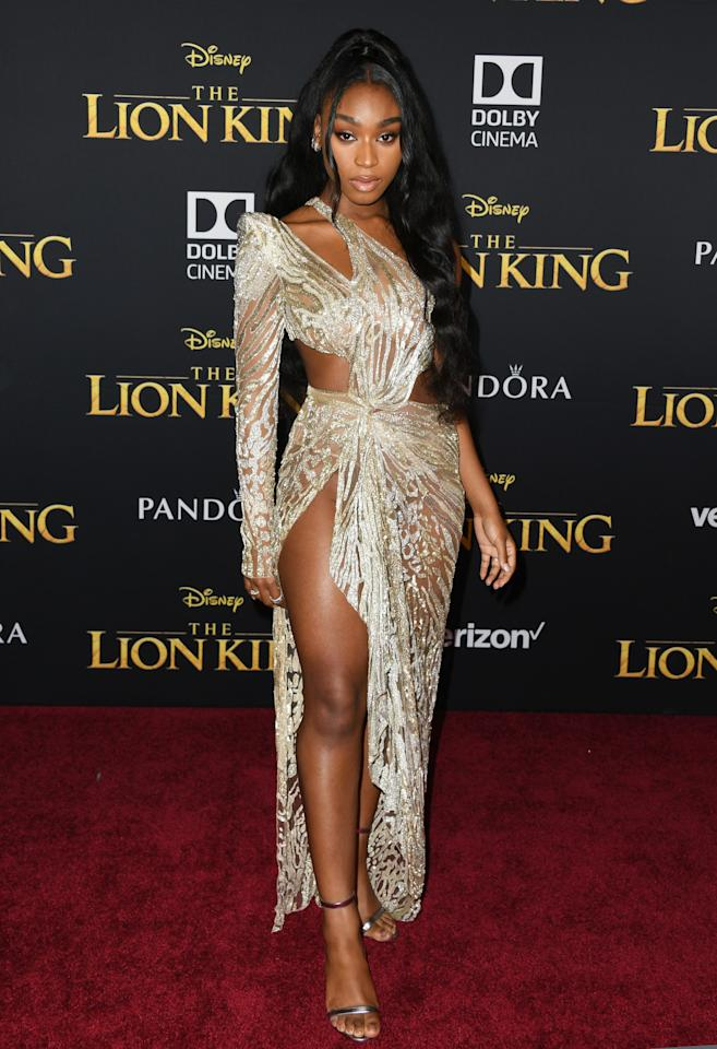 Attending the premiere of <em>The Lion King</em>, Normani looked ready to be made into a Disney princess. She wore a stunning and sparkly golden gown, and paired it with metallic heels and an elegant updo.
