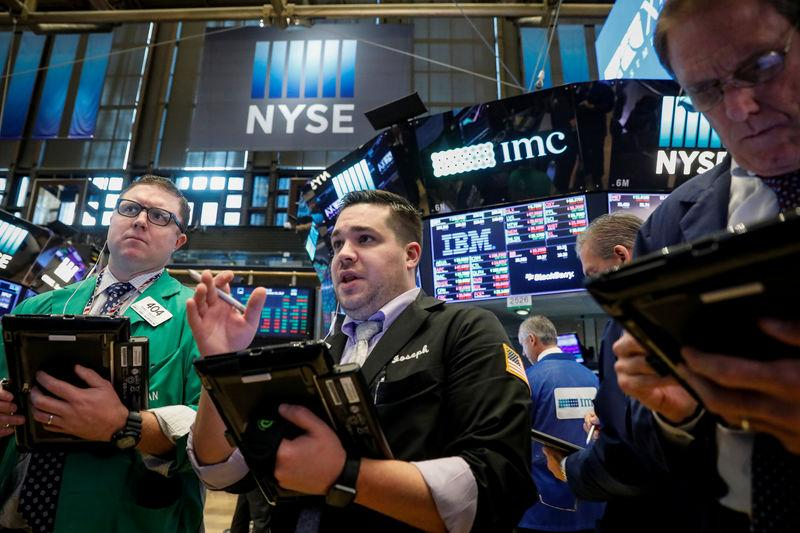 Tech, healthcare stocks lift Wall Street to record high
