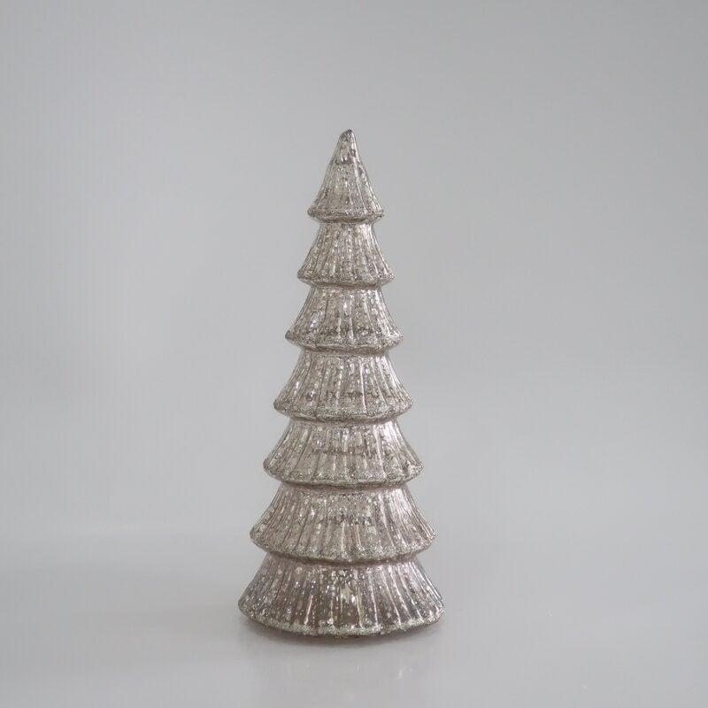 """<br><br><strong>The Holiday Aisle</strong> Ceramic Christmas Tree, $, available at <a href=""""https://go.skimresources.com/?id=30283X879131&url=https%3A%2F%2Fwww.wayfair.com%2Fholiday-decor%2Fpdp%2Fthe-holiday-aisle-christmas-tree-w004287409.html"""" rel=""""nofollow noopener"""" target=""""_blank"""" data-ylk=""""slk:Wayfair"""" class=""""link rapid-noclick-resp"""">Wayfair</a>"""