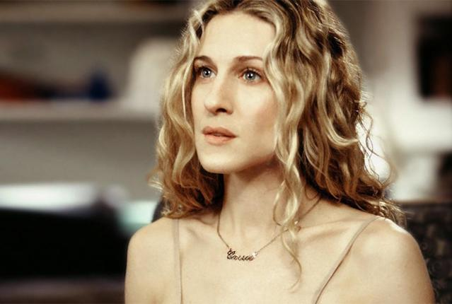 "Carrie Bradshaw and her ""Carrie"" nameplate necklace. (Photo: HBO)"