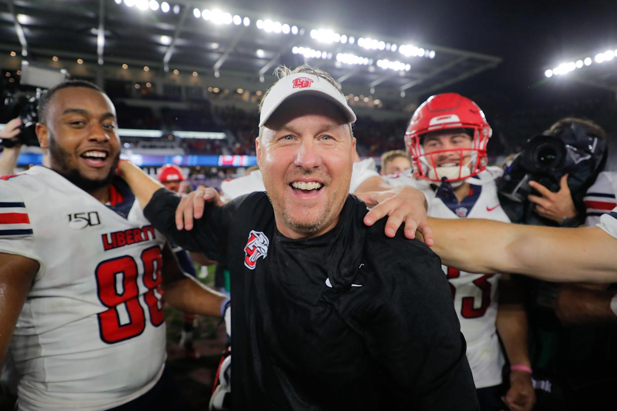 Liberty coach Hugh Freeze celebrates with his team after defeating Georgia Southern in the 2019 Cure Bowl. (James Gilbert/Getty Images)