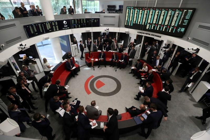 FILE PHOTO: Traders work on the floor of the London Metal Exchange, in London