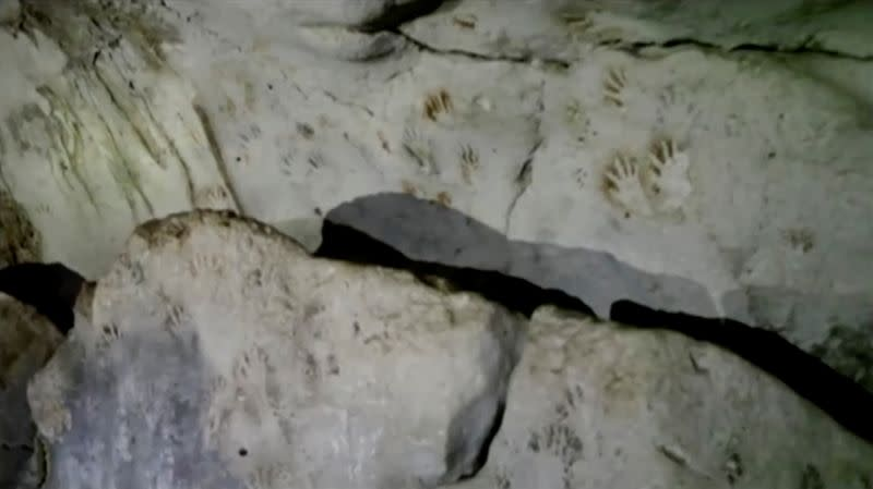 Hand prints, reportedly 1,200 years old, are seen on the cave walls, in Merida