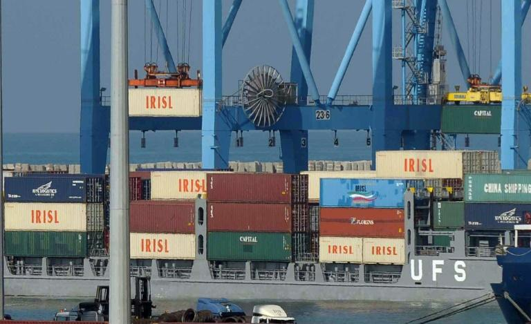 The logo of the Islamic Republic of Iran Shipping Lines (IRISL) is seen on containers being lifted after interception by the Israeli navy in 2009