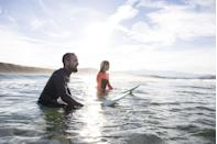 <p>Live in a warm climate? Lucky you. Take advantage of the temps and head to the beach. You can either share a board, and switch off, or ride the waves together. If beaches aren't in your backyard, hop on a skateboard. (Just wear helmets again.)</p>