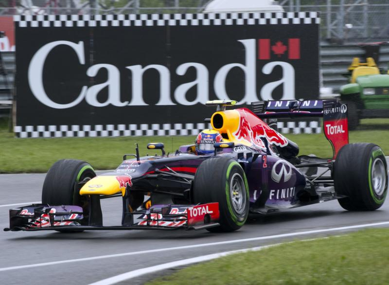"""FILE - This is a Saturday, June 8, 2013, file photo of Red Bull driver Mark Webber, of Australia, as he enters the pits during the morning practice session at the F1 Canadian Grand Prix auto race, in Montreal Canada. Red Bull driver Mark Webber says he is leaving Formula 1 to race Porsche sports cars from next season. The Australian's website says in a statement from Porsche that he has signed a contract with the German company """"that extends over several years"""" and that he will compete in the Le Mans 24 Hours and World Endurance Championship next year. (AP Photo/The Canadian Press, Ryan Remiorz, File)"""