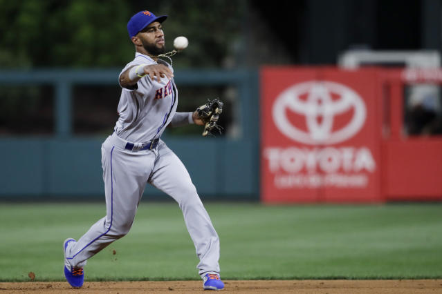 New York Mets' Amed Rosario makes the throw to first forcing out Philadelphia Phillies' Jean Segura during the fourth inning of a baseball game, Friday, Aug. 30, 2019, in Philadelphia. (AP Photo/Matt Rourke)