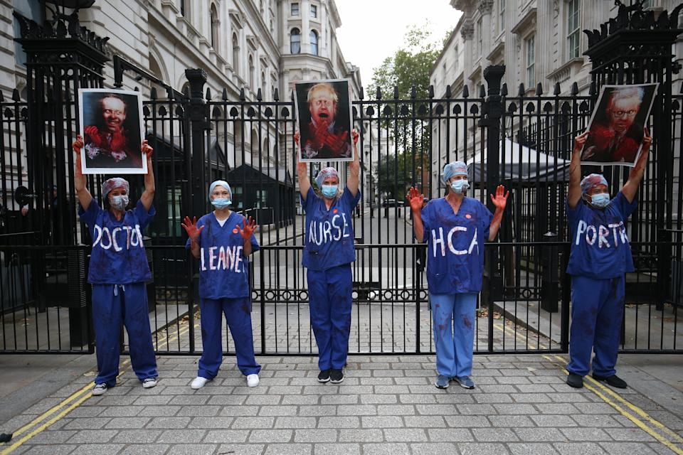 NHS workers outside Downing Street, London, attending a rally to demand the government give them a 15 per cent pay rise.