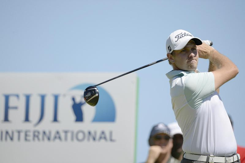 Jake Higginbottom of Australia hits a shot on the final day of the Fiji International golf tournament, at the Natadola Bay Championship golf course in Nadi, on August 17, 2014 (AFP Photo/Paul Lakatos)