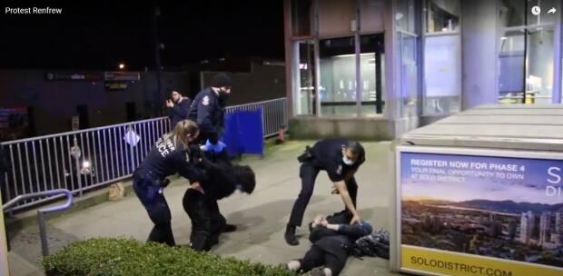 Vancouver Police say two protesters were arrested after allegedly assaulting officers during an anti-pipeline railway blockade early Saturday morning.  (Ryan Stelting - image credit)