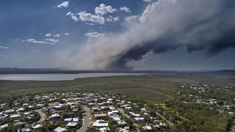 Thousands of Queensland residents have been evacuated in as bushfires continue to burn