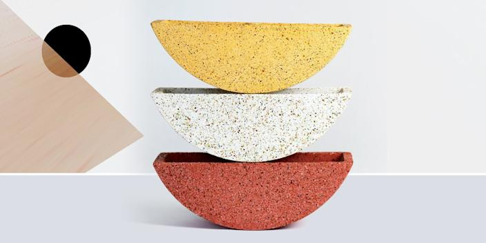"""<div class=""""caption""""> Trendy terrazzo has made it to the plant world in the form of these half-moon pots. <br> <a href=""""https://www.pretti.cool/shop/the-totter-planter"""" rel=""""nofollow noopener"""" target=""""_blank"""" data-ylk=""""slk:SHOP NOW"""" class=""""link rapid-noclick-resp"""">SHOP NOW</a>: The Totter Planter by Pretti.Cool, 12""""w x 3""""d x 5""""h, $65, pretti.cool<br> </div> <cite class=""""credit"""">Photo courtesy of Pretti.Cool</cite>"""