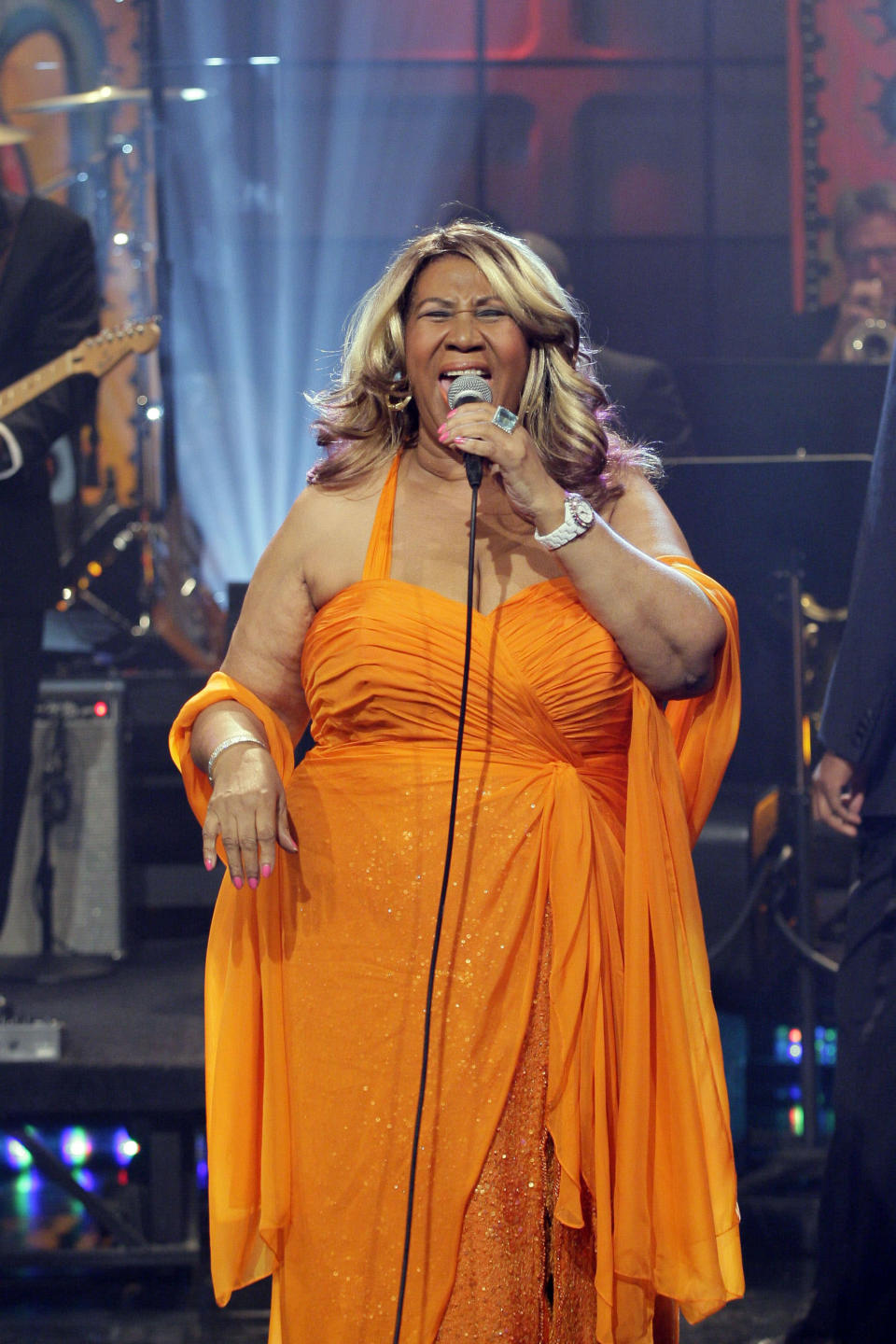 """<p>Aretha Franklin wears an orange ruched halter sequin dress and bright blond hair during a performance on """"The Tonight Show with Jay Leno."""" (Photo by: Stacie McChesney/NBC/NBCU Photo Bank) </p>"""