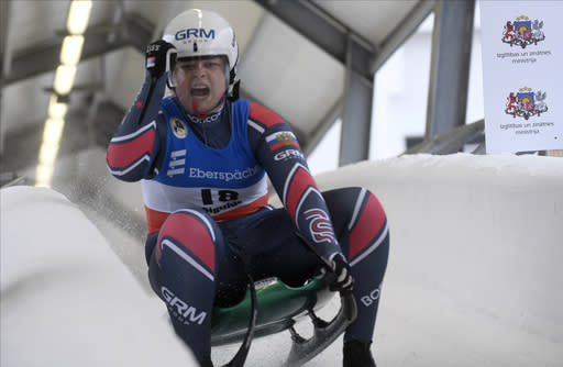 Viktoriia Demchenko of Russia reacts after shefinished third in a women's race at the Luge World Cup event in Sigulda, Latvia, Sunday, Jan. 10, 2021. (AP Photo/Roman Koksarov)