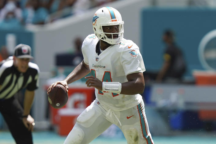 Miami Dolphins quarterback Jacoby Brissett (14) looks to pass the ball, during the first half of an NFL football game against the Buffalo Bills, Sunday, Sept. 19, 2021, in Miami Gardens, Fla. (AP Photo/Hans Deryk)