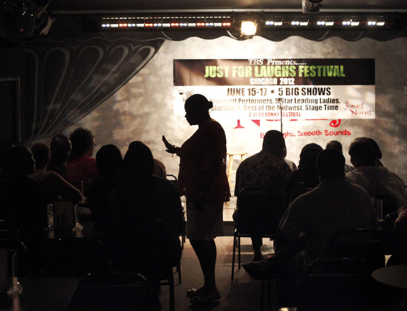 In this June 8, 2012 photo, Mary Lindsey, owner if the Jokes and Notes comedy club is silhouetted as she seats guest for the first of two shows in Chicago's Bronzeville neighborhood. African-American female club owners are a rarity in the industry of comedy, but Lindsey is breaking barriers and uplifting a community by providing a place where raw comedic talent can hone their skills. (AP Photo/Charles Rex Arbogast)