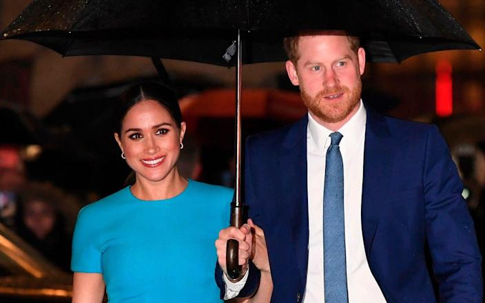 (FILES) In this file photo taken on March 5, 2020 Britain's Prince Harry, Duke of Sussex (R) and Meghan, Duchess of Sussex arrive to attend the Endeavour Fund Awards at Mansion House in London. - Prince Harry and Meghan Markle filed a lawsuit July 23 in Los Angeles against one or more paparazzi whom they accuse of taking pictures of their son without permission, their lawyer told AFP. (Photo by DANIEL LEAL-OLIVAS / AFP) (Photo by DANIEL LEAL-OLIVAS/AFP via Getty Images) - Daniel Leal-Olivas/AFP via Getty Images