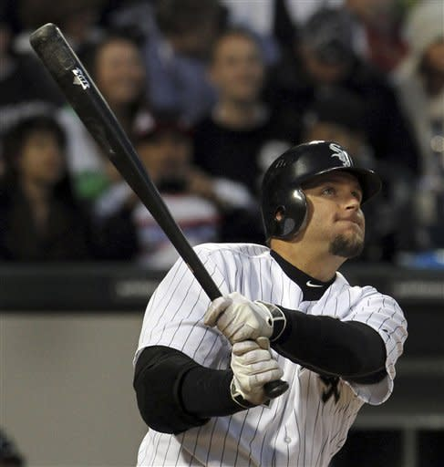 Chicago White Sox's A.J. Pierzynski watches his second-inning home run against the Baltimore Orioles in a baseball game Monday, April 16, 2012, in Chicago. (AP Photo/John Smierciak)