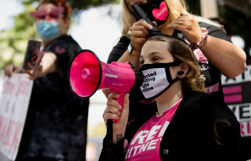 Supporter Jennifer Preston gets a haircut during a rally for pop star Britney Spears during a conservatorship case hearing at Stanley Mosk Courthouse in Los Angeles