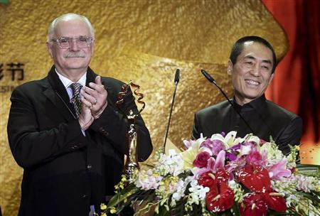 Russian director Nikita Mikhalkov and Chinese director Zhang Yimou present the Tiantan Award of Best Film during the closing ceremony of the Beijing International Film Festival