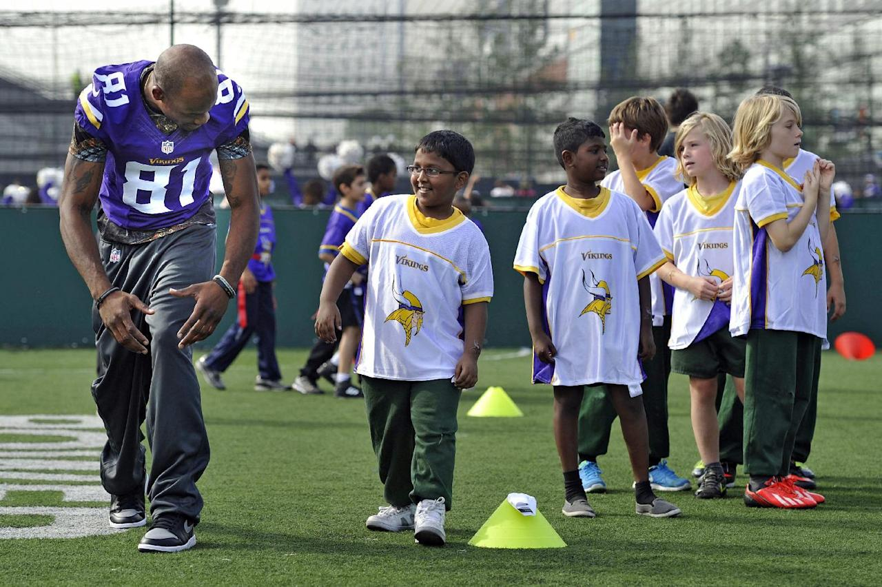 Jerome Simpson of the Vikings takes part in a coaching clinic with London children near Wembley Stadium, London, Tuesday Sept. 24, 2013. The Pittsburgh Steelers are to play the Minnesota Vikings in the NFL International Series at Wembley Stadium in London on Sunday, Sept 29. (AP Photo/Sean Ryan, NFL)