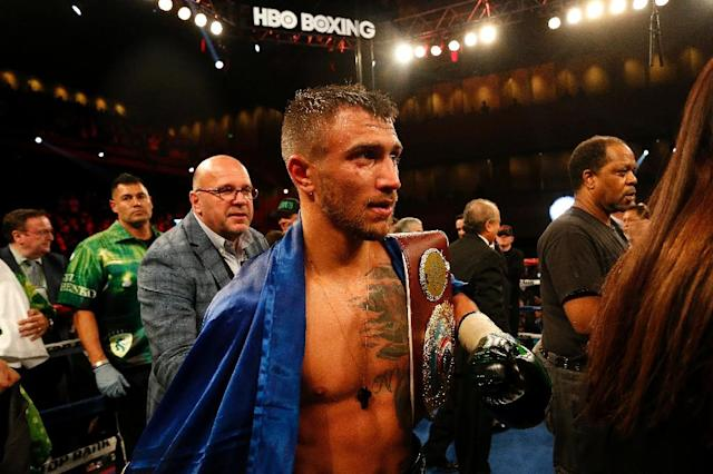 Vasyl Lomachenko of Ukraine leaves the ring after defeating Jason Sosa of the US in their WBO super featherweight world championship bout, at MGM National Harbor in Oxon Hill, Maryland, on April 8, 2017 (AFP Photo/Matt Hazlett)