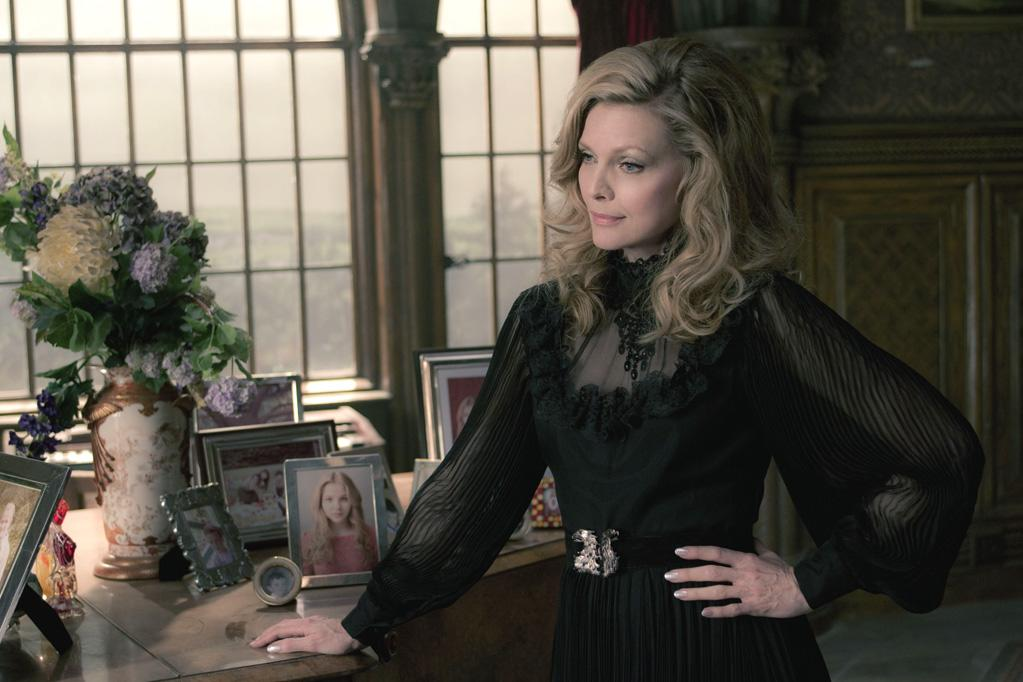 "<b>It's Who You Know</b><br>Michelle Pfeiffer, who plays matriarch Elizabeth Collins Stoddard, was also a ""Dark Shadows"" devotee. After hearing Burton was attached to direct, Pfeiffer decided to rekindle her old relationship with the man who helped her nail another shadowy role: Catwoman in ""Batman Returns"" (1992). ""I was attracted to the project initially, I didn't even know if there was a role for me. I heard Tim was doing the movie; I called him, which I never do – I hadn't talked to him in 20 years – and I just said, 'Look, I just need to go on record as saying I would love to be a part of this. I don't know if there's anything for me.' And a year later, he called. And he had this great part for me,"" <a href=""http://www.imdb.com/list/9nXlLnUrXQY/"">says Pfeiffer</a>."