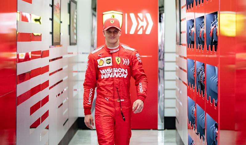 BAHRAIN, BAHRAIN - APRIL 02: Mick Schumacher of Germany and Scuderia Ferrari SF90 walks out of the garage during F1 testing in Bahrain at Bahrain International Circuit on April 02, 2019 in Bahrain, Bahrain. (Photo by Lars Baron/Getty Images)