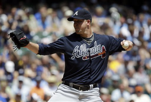 Atlanta Braves starting pitcher Paul Maholm throws during the first inning of a baseball game against the Milwaukee Brewers, Sunday, June 23, 2013, in Milwaukee. (AP Photo/Morry Gash)
