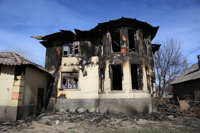 A view shows a burnt house following a series of clashes in Zhambyl province