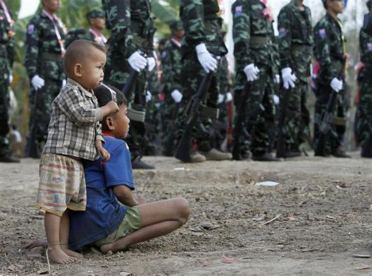 Children watch the festivities during the 63rd anniversary of Karen Revolution Day at Oo Kray Kee Township in the Karen State, along the Thai-Myanmar border, January 31, 2012.